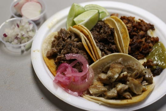 Four types of tacos at Lonchera la Guadalupana, practically overflowing, on October 2, 2018.