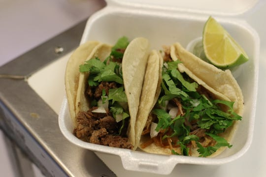 Carne asada and carnitas tacos to go at Carniceria La Consentida on October 2, 2018.