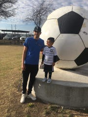 Former Lake View High School soccer standout Jordan Reyes is shown here with his son, Nickoli.
