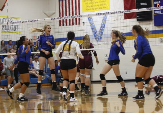 Veribest High School's Kameron Salvato (21) celebrates with her teammates after a successful kill attempt against Bronte. Veribest rallied to beat the defending state champion Lady Longhorns in a five-set thriller Tuesday, Oct. 2, 2018, in Veribest.