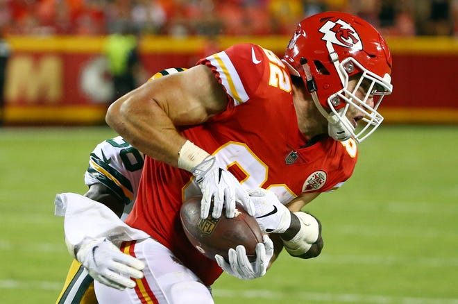 Aug 30, 2018; Kansas City, MO, USA; Kansas City Chiefs tight end Alex Ellis (82) is tackled by Green Bay Packers defensive back Raven Greene (36) in the second half at Arrowhead Stadium. Mandatory Credit: Jay Biggerstaff-USA TODAY Sports