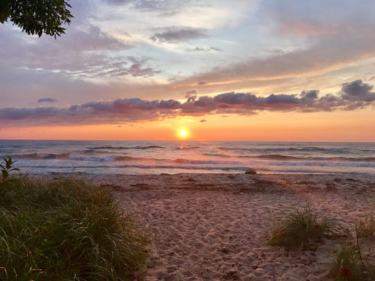 A lakeside sunset in Sheboyan is featured in a photo taken by BethMontgomery-Burns in the Discover Wisconsin 2019 calendar for the month of August.