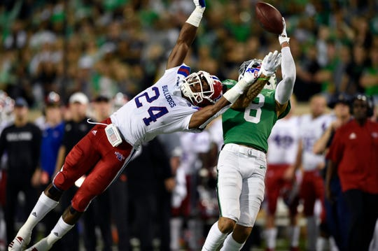 Louisiana Tech's L'Jarius Sneed covers North Texas wide receiver Rico Bussey Jr. (8) during Saturday's game.