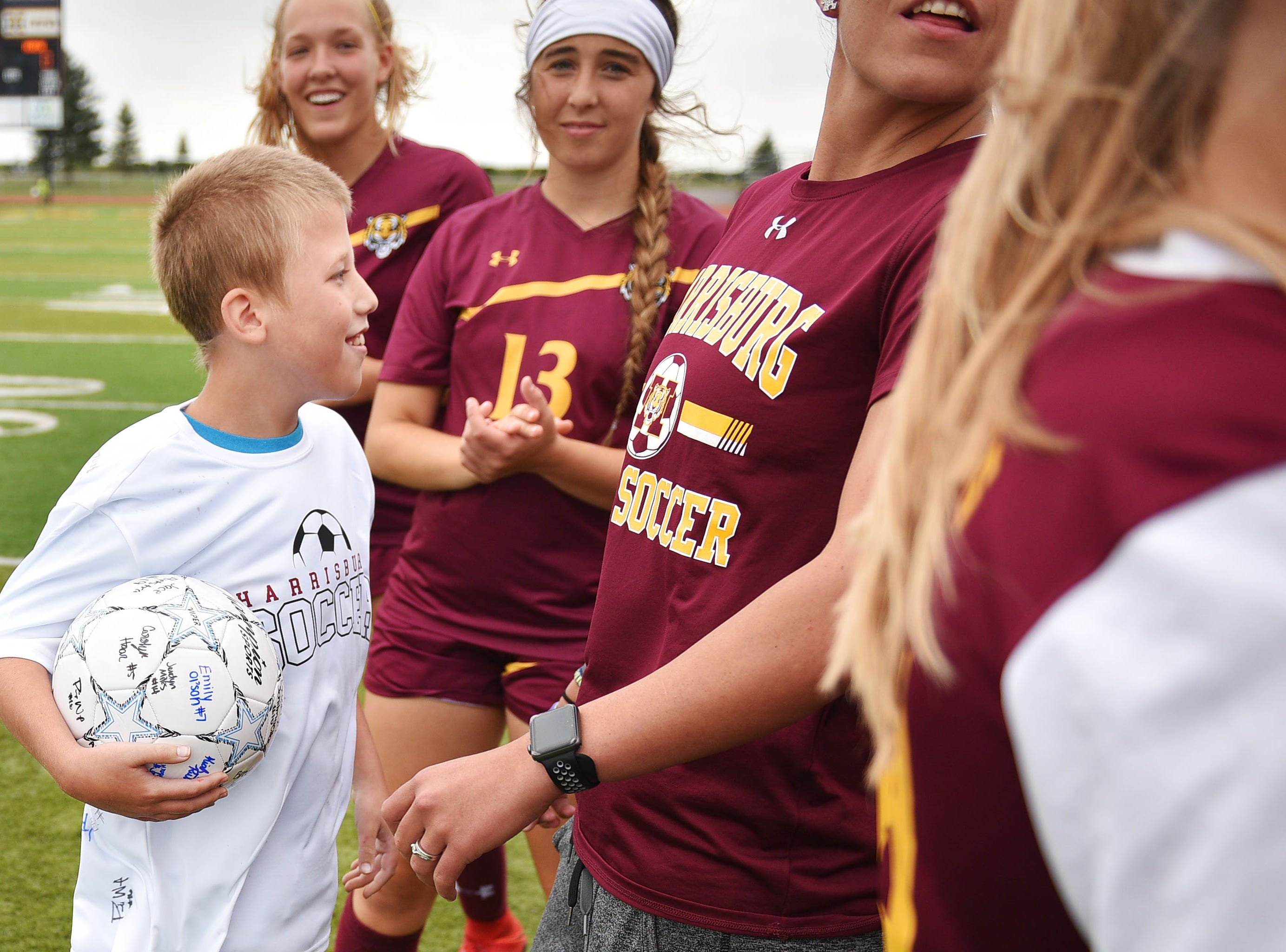 Corey Surikov huddles with Harrisburg soccer players before the game against Hurron Thursday, Sept. 13, at Harrisburg. Corey Surikov and Grant Hamilton were named Players of the Game.