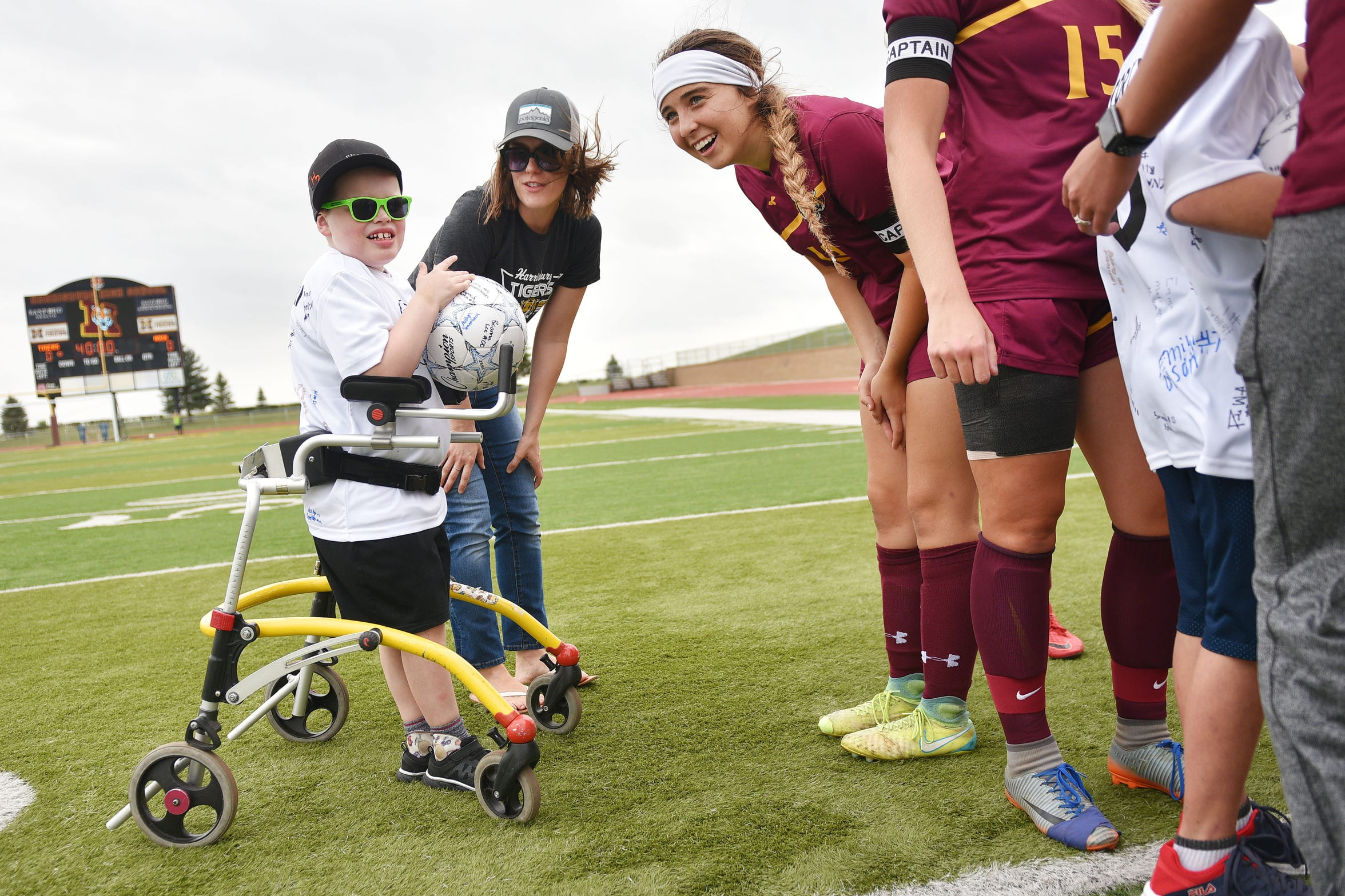 Kate Hamilton talks to her son Grant on the field with Harrisburg player Lily Petersen before the Harrisburg vs Hurron game Thursday, Sept. 13, at Harrisburg. Grant Hamilton and Corey Surikov were named Players of the Game.