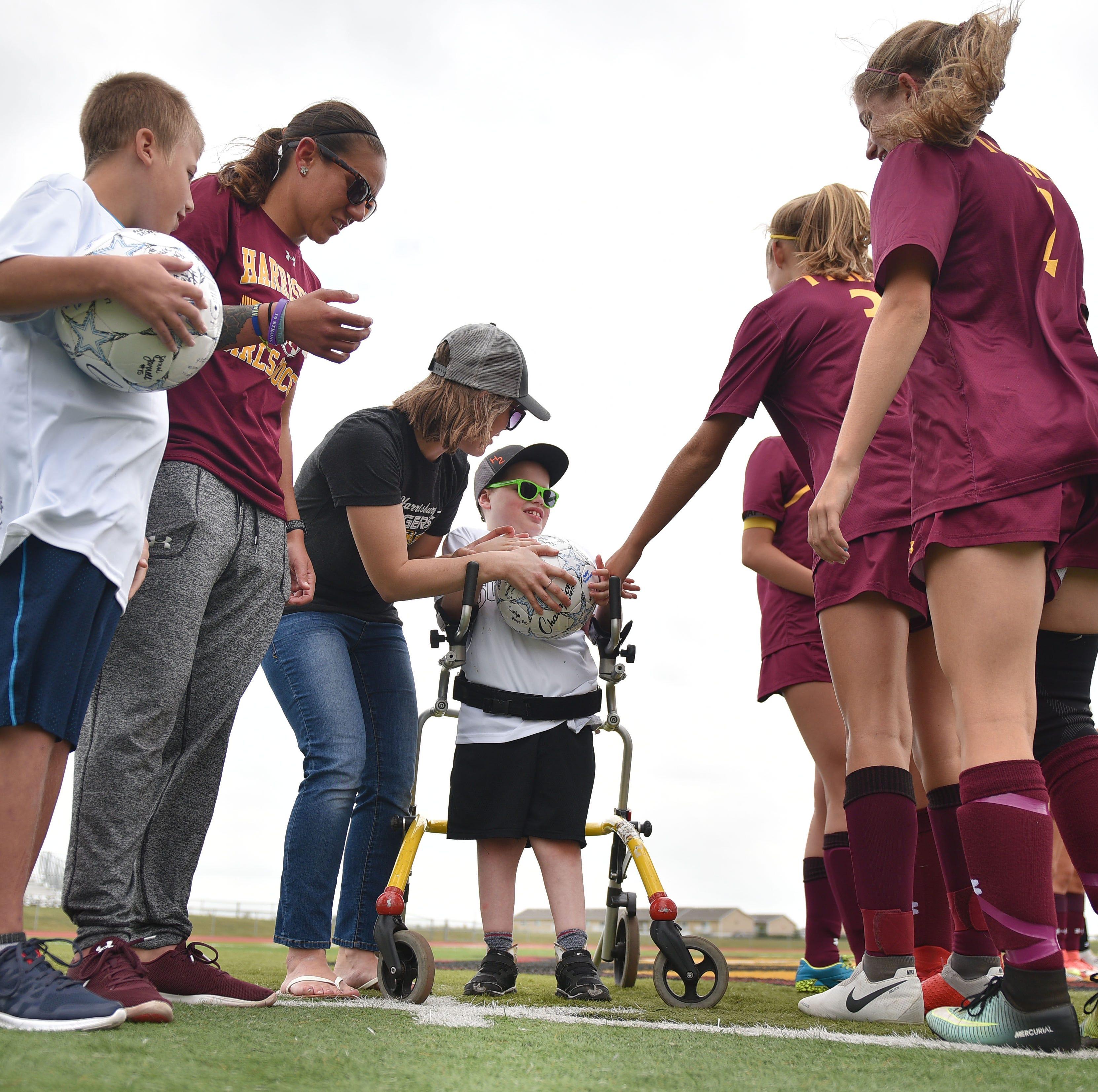Heroes at heart: Harrisburg soccer team finds higher calling
