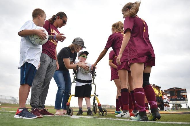 Corey Surikov and Grant Hamilton are named Players of the Game for the girls soccer Harrisburg vs Hurron game Thursday, Sept. 13, at Harrisburg.
