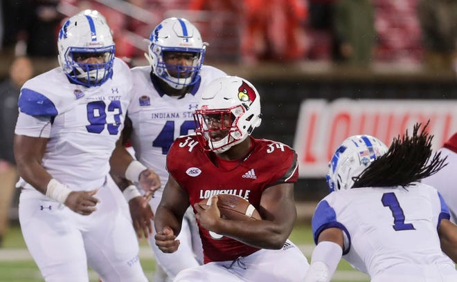 Indiana State players defend against Louisville