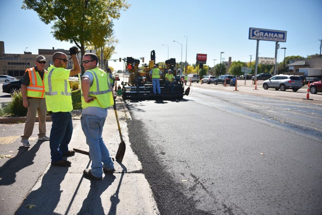 City of Sioux Falls street department repaves Minnesota Ave Wednesday, Oct. 3, near downtown Sioux Falls.