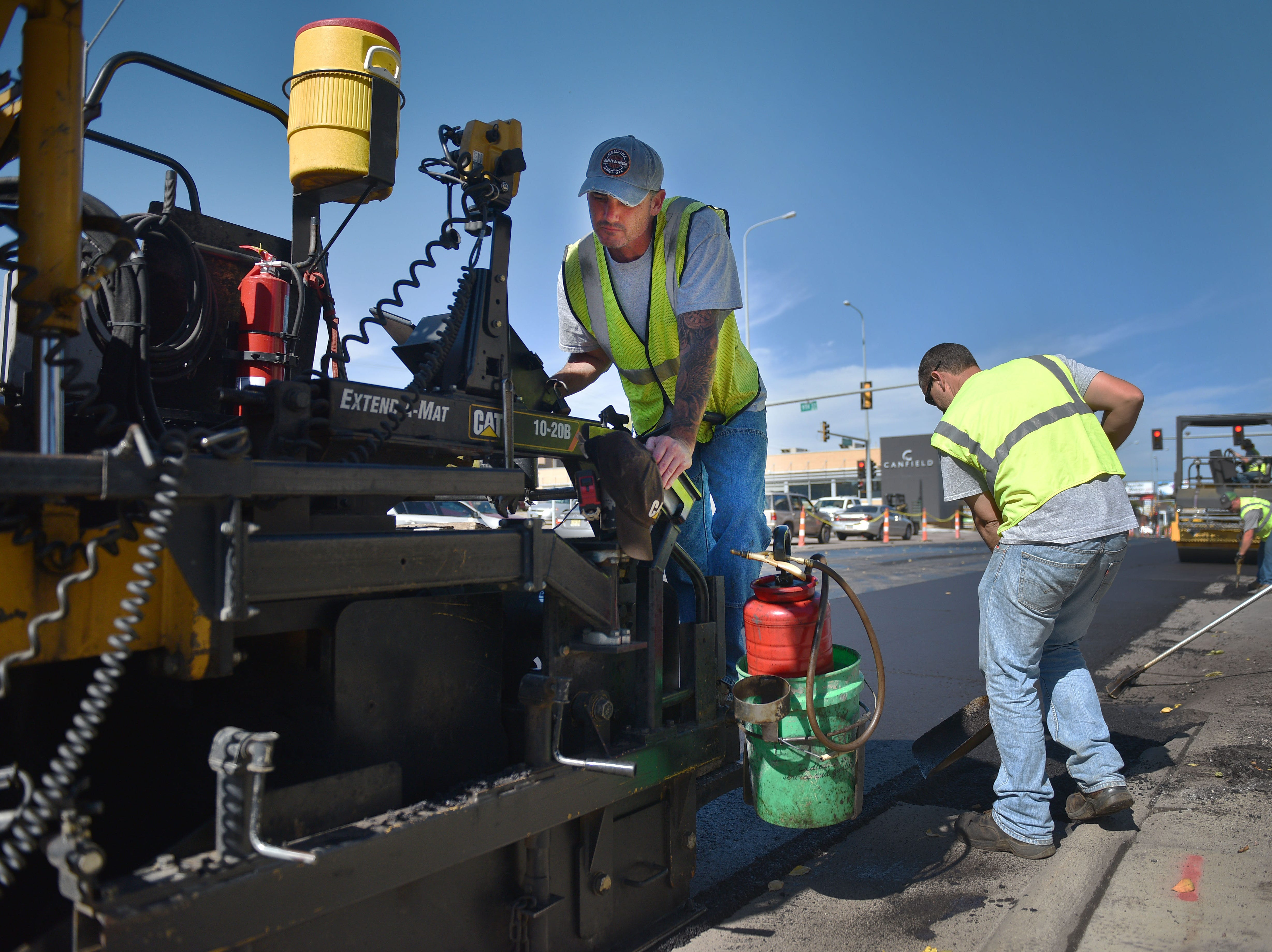 City of Sioux Falls street department Ben Schaaf repaves Minnesota Ave with other street department employees Wednesday, Oct. 3, near downtown Sioux Falls.