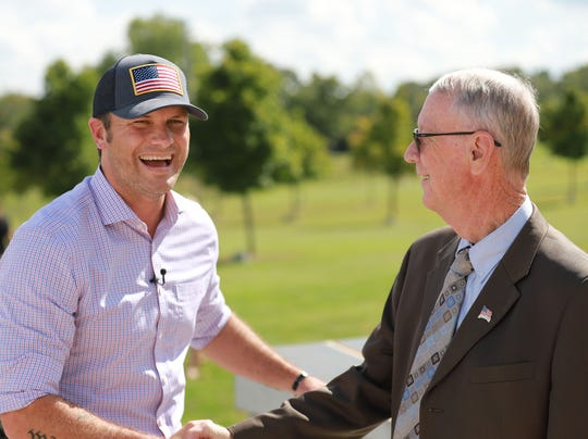 Pete Hegseth shakes hands with College of the Ozarks President Jerry C. Davis.