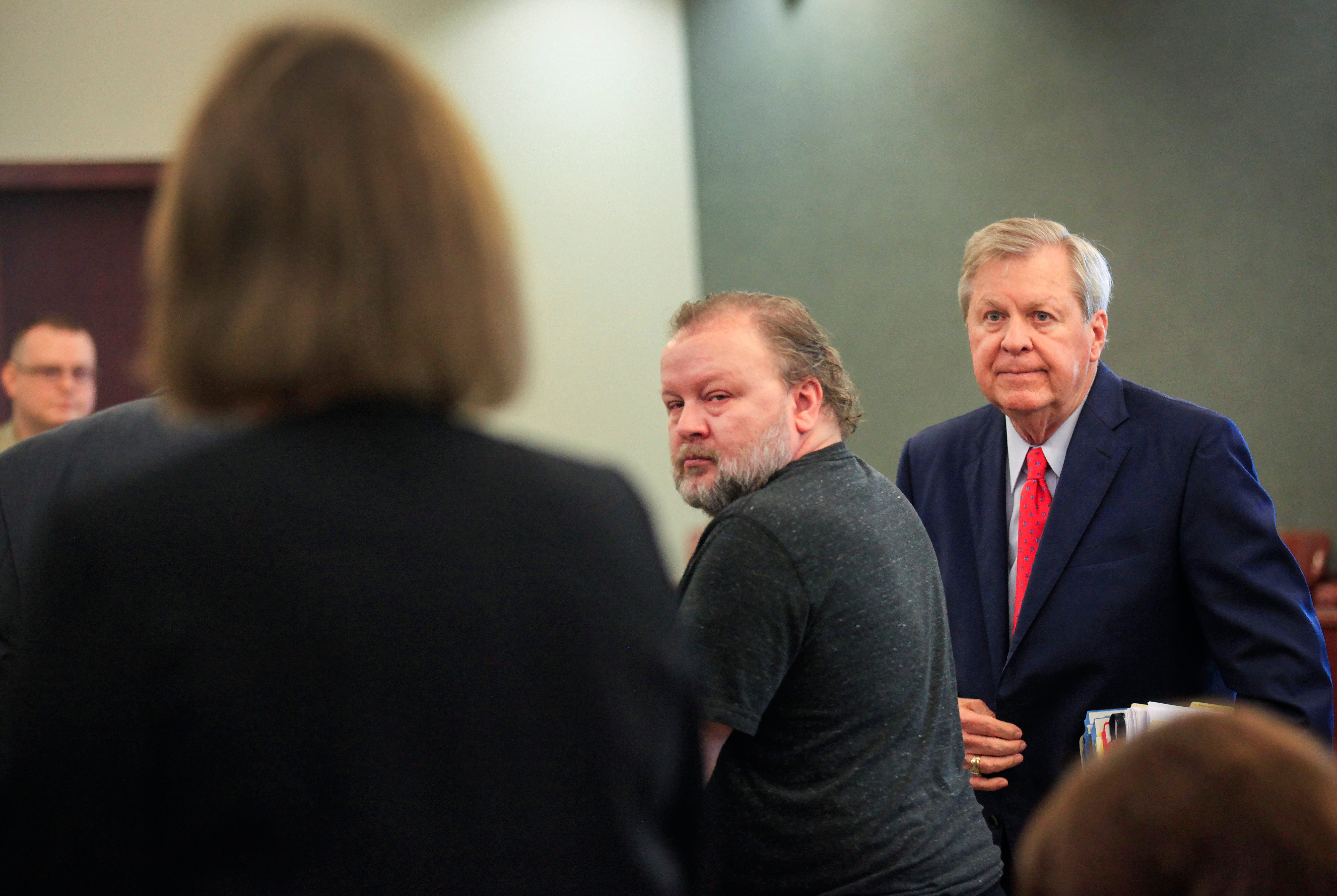 Benjamin Lambert, center, was arraigned and pleaded not guilty to charges of child sex trafficking at the Christian County courthouse on Wednesday, Oct. 3, 2018. Also pictured is one of Lambert's lawyers, Dee Wampler.