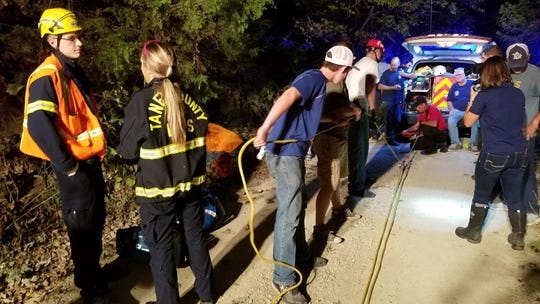 A crew prepares for a rescue operation at a cave in Taney County.