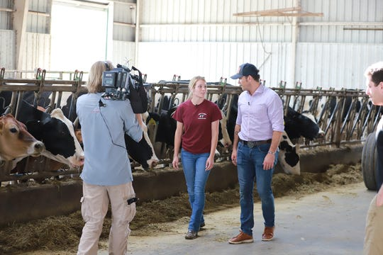 Senior Kaedyn Palmer takes Hegseth on a tour of the dairy barn.