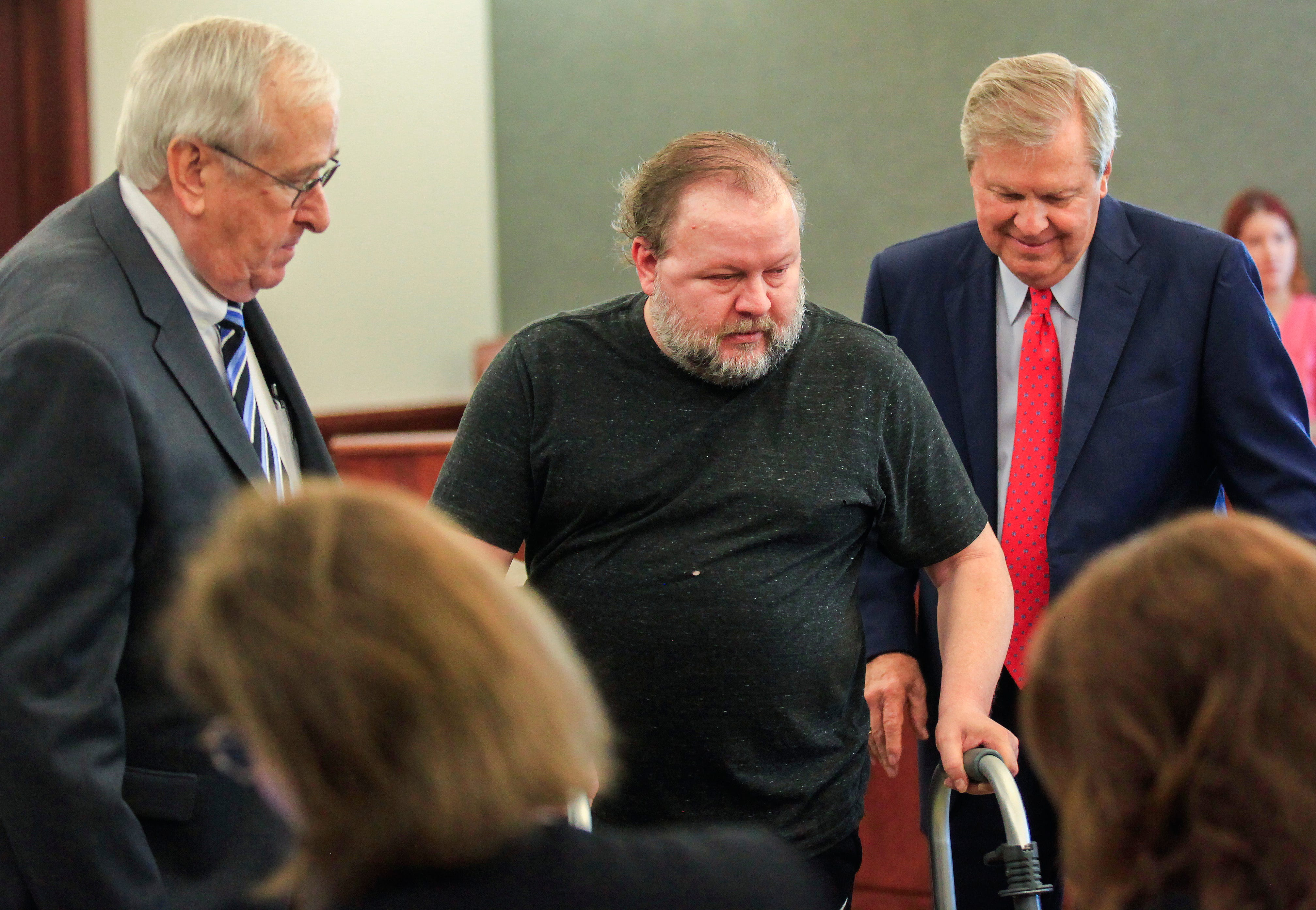 Benjamin Lambert, center, was arraigned and pleaded not guilty to charges of child sex trafficking at the Christian County courthouse on Wednesday, Oct. 3, 2018. Also pictured are Lambert's lawyers, Dee Wampler, right, and Marvin Gilmore, left.