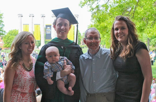 Pictured (from left) are Erin (Stuppy) Wingbermuehle, Adam Stuppy (holding his son Bryce), Mark Stuppy and Adam's wife, Gerri Stuppy. This was taken in 2014 when Adam graduated from medical school.