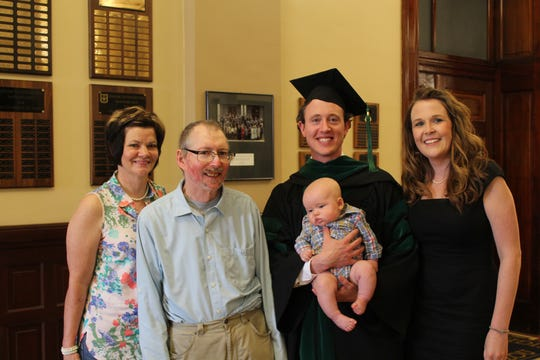 Pictured (from left) is Kendra Stuppy, Mark Stuppy, Adam Stuppy holding his son Bryce, and Adam's wife, Gerri Stuppy. This was taken when Adam graduated from medical school in 2014.