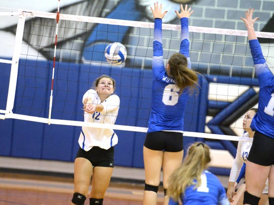 Fort Defiance's Maggie Trainum (12) reaches for a ball during a match with Rockbridge County Tuesday night.
