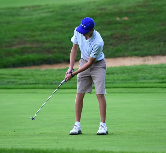 Robert E. Lee's Mason Wyatt follows through on a putt on the 18th green during the VHSL Class 2, Region B golf championships on Tuesday, Oct. 2, 2018, at Heritage Oaks Golf Course in Harrisonburg, Va.