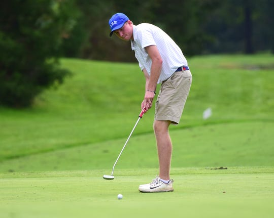 Robert E. Lee's Thomas Otteni putts on the 11th green during the VHSL Class 2, Region B golf championships on Tuesday, Oct. 2, 2018, at Heritage Oaks Golf Course in Harrisonburg, Va.