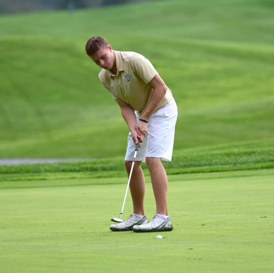 Wilson Memorial's Grayson Wright watches his birdie putt fall into the cup on the 18th green during the VHSL Class 2, Region B golf championships on Tuesday, Oct. 2, 2018, at Heritage Oaks Golf Course in Harrisonburg, Va.