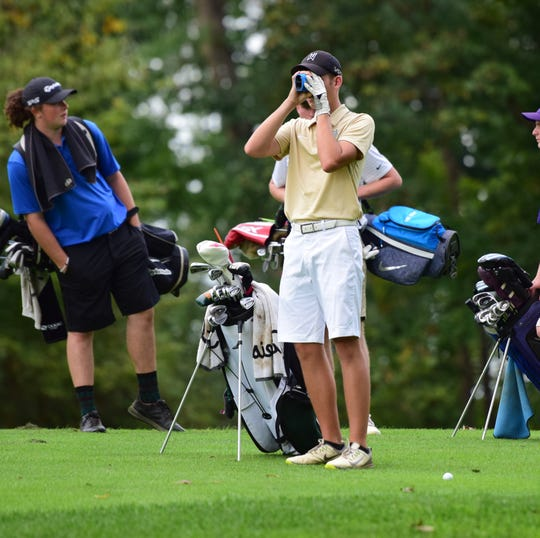 Wilson Memorial's Patrick Smith checks the distance to the green before he hits from the 15th fairway during the VHSL Class 2, Region B golf championships on Tuesday, Oct. 2, 2018, at Heritage Oaks Golf Course in Harrisonburg, Va.