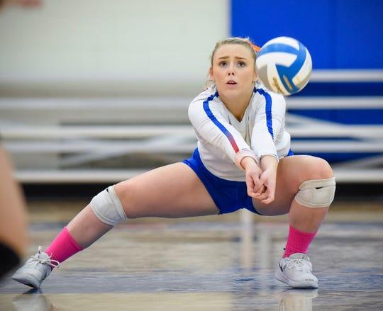 Apollo's Kaleigh Schuck bumps a Tech serve toward the net during the first game Tuesday, Oct. 2, at Apollo High School.