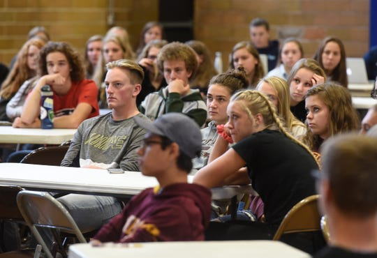 Students listen to speakers during the Granite Ridge Conference leadership conference Wednesday, Oct. 3, at Cathedral High School in St. Cloud.