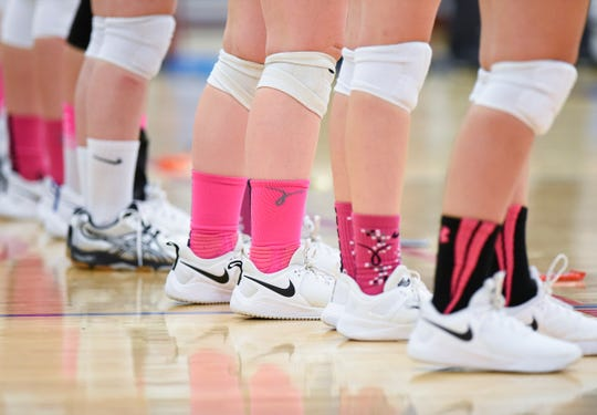 Apollo volleyball players wear pink socks for National Breast Cancer Awareness Month during their match Tuesday, Oct. 2, at Apollo High School.