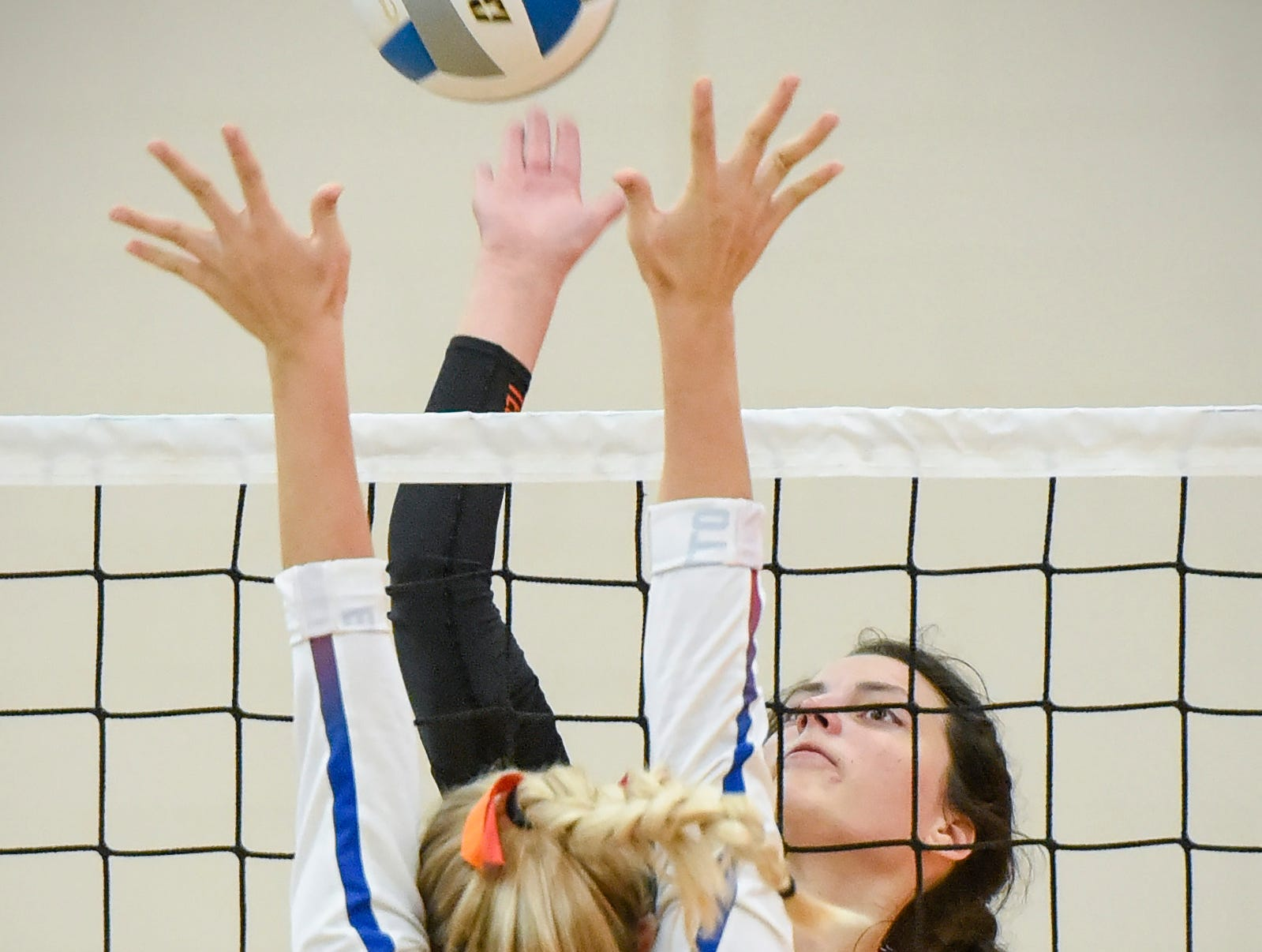 Tech's Jessica Schoborg spikes the ball at Apollo's Olivia Hoeschen during the first game Tuesday, Oct. 2, at Apollo High School.