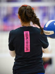 Apollo volleyball players wear shirts with Digging For A Cure on the back during warmups Tuesday, Oct. 2, for the Tech match at Apollo High School.
