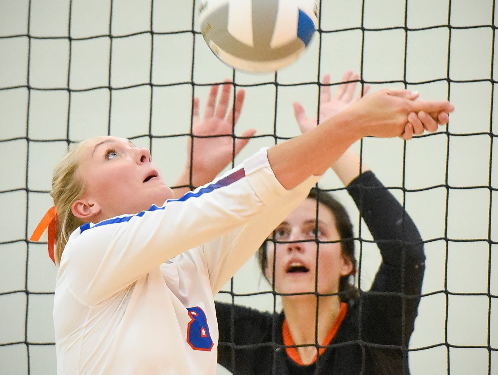 Apollo's Olivia Hoeschen bumps the ball up at the net against Tech during the third game Tuesday, Oct. 2, at Apollo High School.