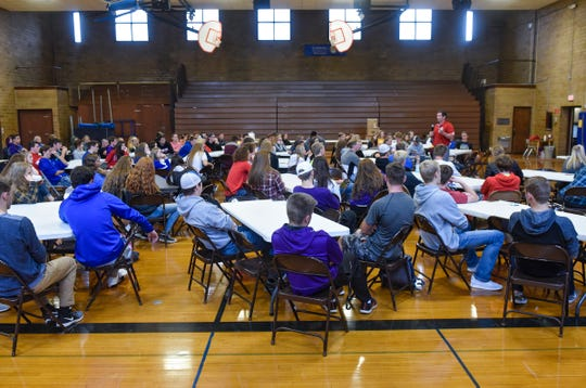 Students listen to a presentation during the Granite Ridge Conference leadership conference Wednesday, Oct. 3, at Cathedral High School in St. Cloud.
