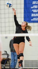 Tech's Madysen Settel hits the ball to Apollo during the first game Tuesday, Oct. 2, at Apollo High School.