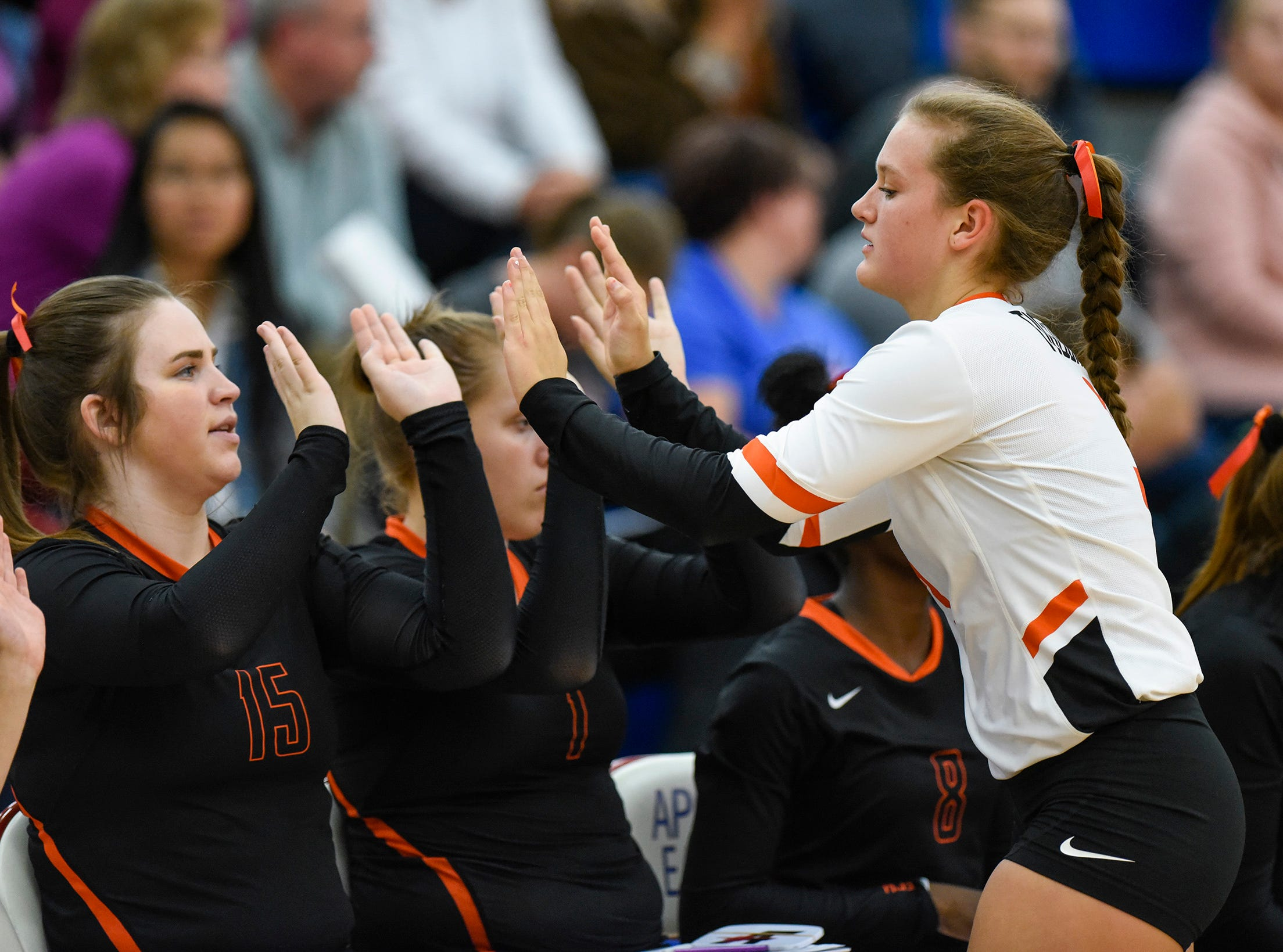 Tech's Rachel Matz is met by teammates as she comes off the court against Apollo during the second game Tuesday, Oct. 2, at Apollo High School.