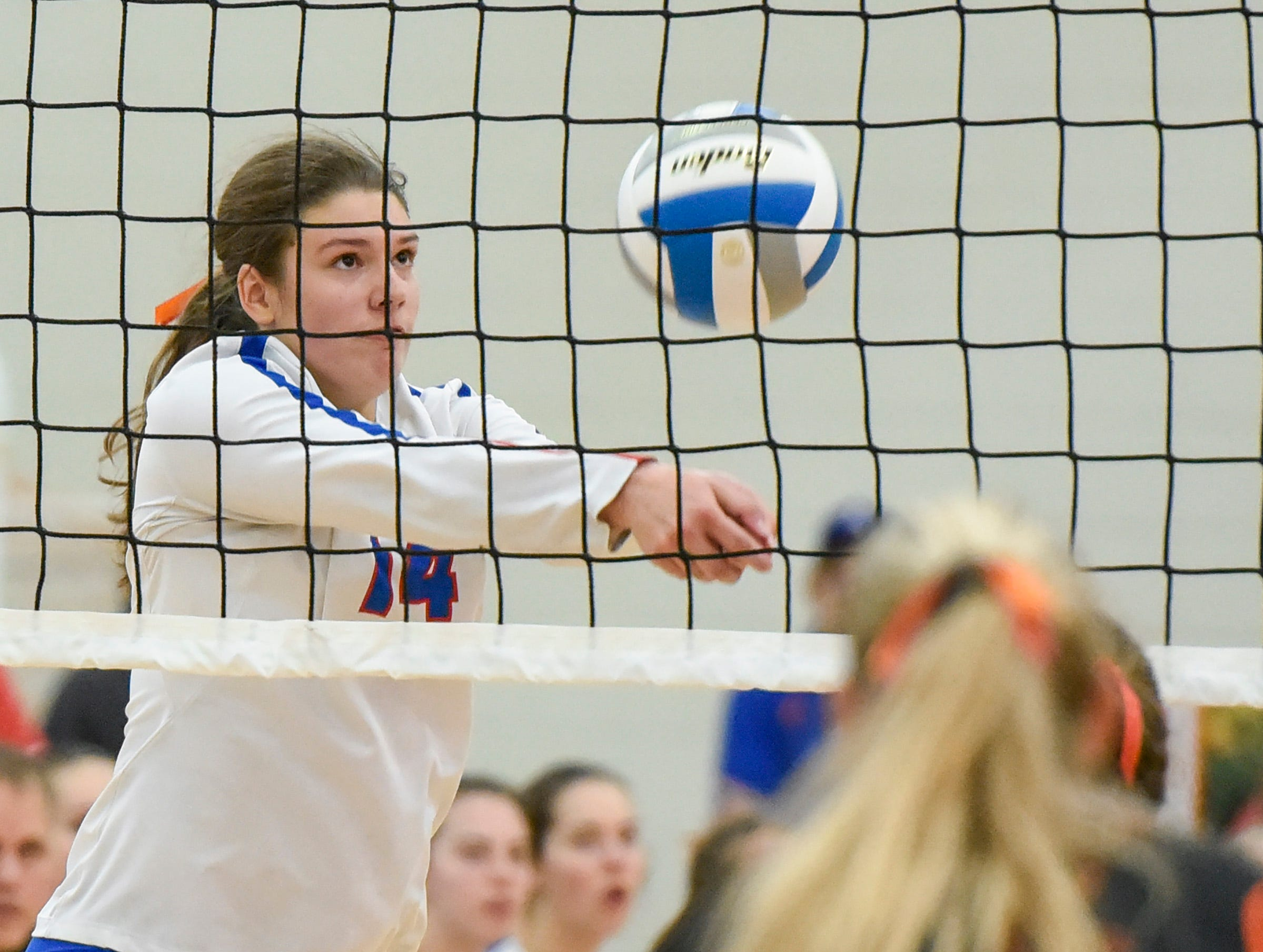 Apollo's Paige Cox bumps the ball up at the net against Tech during the second game Tuesday, Oct. 2, at Apollo High School.