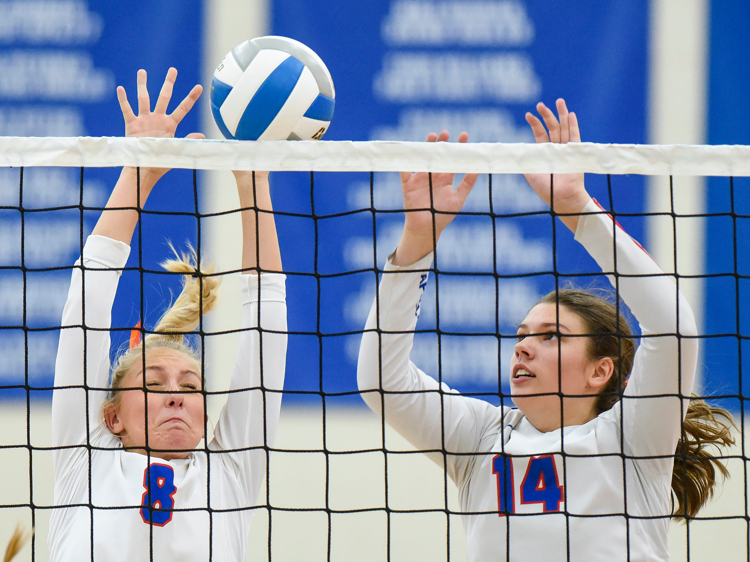 Apollo's Olivia Hoeschen and Paige Cox try to block the ball at the net against Tech during the second game Tuesday, Oct. 2, at Apollo High School.