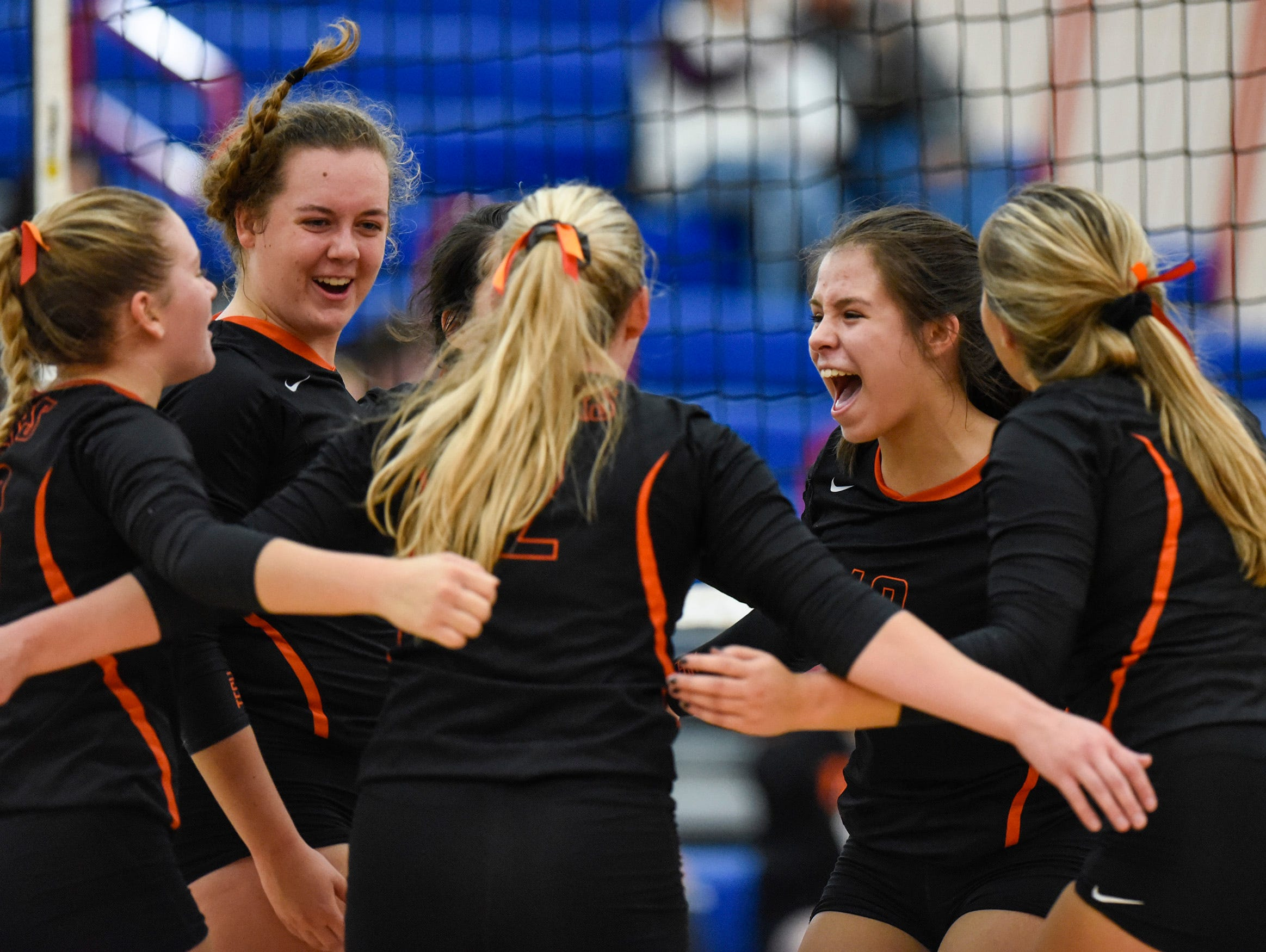 Tech players celebrate a point against Apollo during the second game Tuesday, Oct. 2, at Apollo High School.