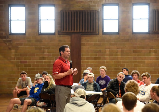 St. John's University football head coach Gary Fasching speaks during the morning session of the Granite Ridge Conference leadership conference for student athletes Wednesday, Oct. 3, at Cathedral High School in St. Cloud.