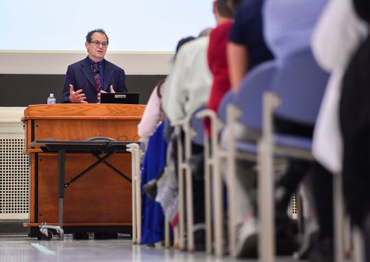 Dr. Miles Belgrade, Minneapolis, speaks to medical staff about managing pain of substance abusers and alternative pain treatments Wednesday, Oct. 3, at the St. Cloud VA Health Care System.