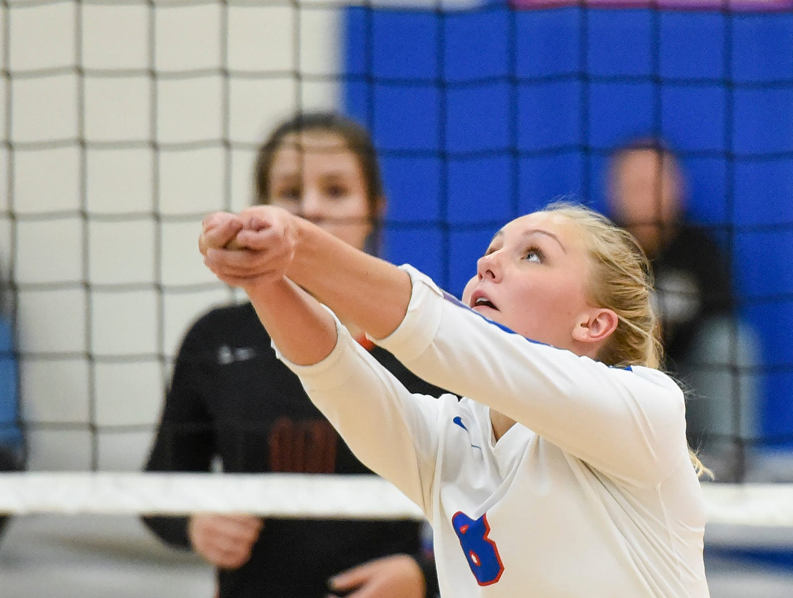 Apollo's Olivia Hoeschen bumps the ball up against Tech during the third game Tuesday, Oct. 2, at Apollo High School.