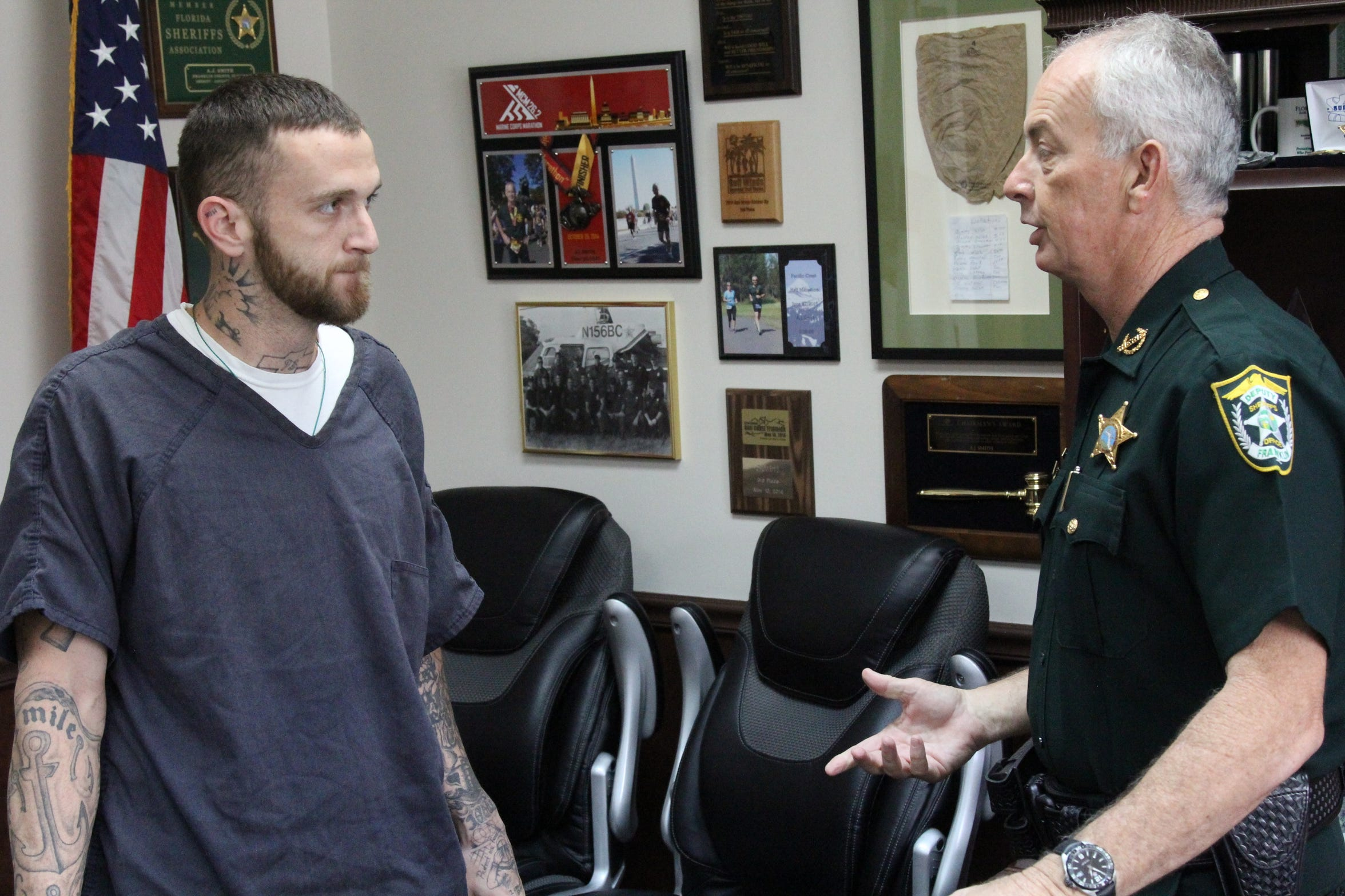 Austin Smith, 24, talks with Sheriff A.J. Smith in the Franklin County Jail.
