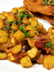 Onions and bacon add to the flavor of German Fried Potatoes.