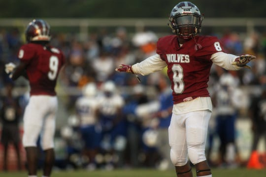 Chiles cornerback Tay Nathan makes a hand signal with his sideline during a game against Godby earlier this year.