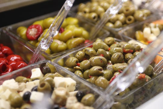 """The """"finds"""" section of the new GreenWise Market features 230 different varieties of cheeses, paired with wine, olives and salamis."""