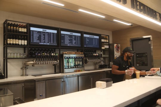 """The """"pours"""" section of the new GreenWise Market features beer, tea, coffee, smoothies and more."""