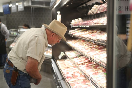 Will Harris, owner of White Oak Pastures, checks out the selection of meats from his farm on display in the new GreenWise Market during their preview event in the CollegeTown area of Tallahassee, Fla.Wednesday, Oct. 3, 2018.