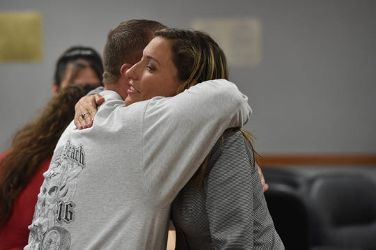 Victim Brian Johnston hugs with Assistant District Attorney Rebecca white after sentencing for Ivan Louis Rodriguez, 49, before Circuit Judge Steven Levin at the St. Lucie Courthouse on Wednesday, Oct. 3, 2018, in Fort Pierce.