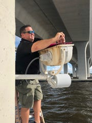 Deputy James Holloran of the Martin County Sheriff's Office, assisted by Stuart Police, took part in the installation effort.