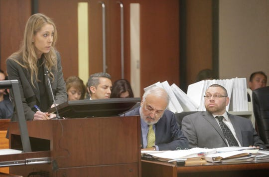 Assistant District Attorney Denise Butterworth asks a witness, not shown, a question during the second day in the trial of Daniel Villegas, far right, as his attorney, Joe Spencer, takes notes.